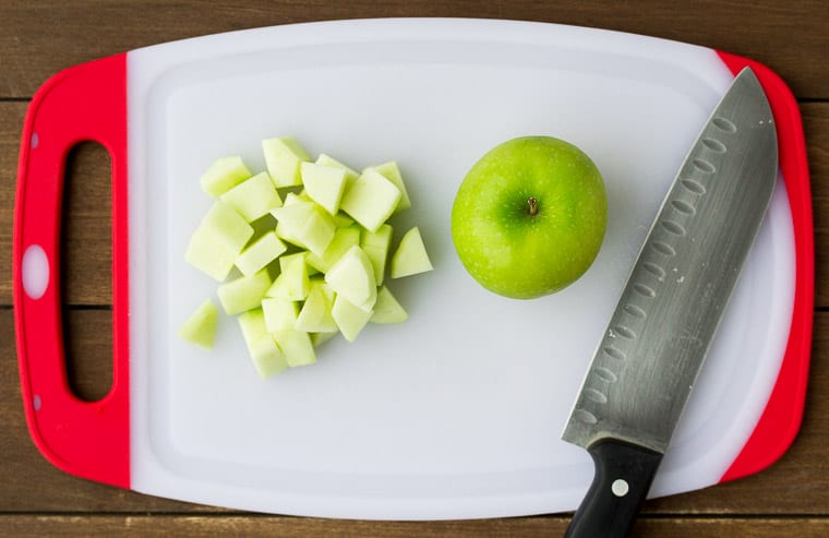 Diced Apple on a Cutting Board with a Knife