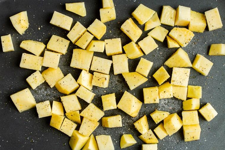 Cubes raw rutabaga on a baking sheet