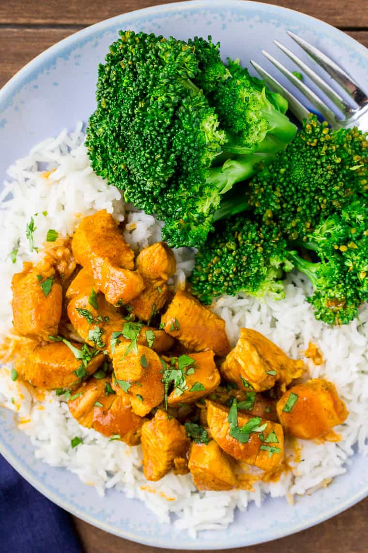 Coconut Curry Chicken with Broccoli on a light blue plate