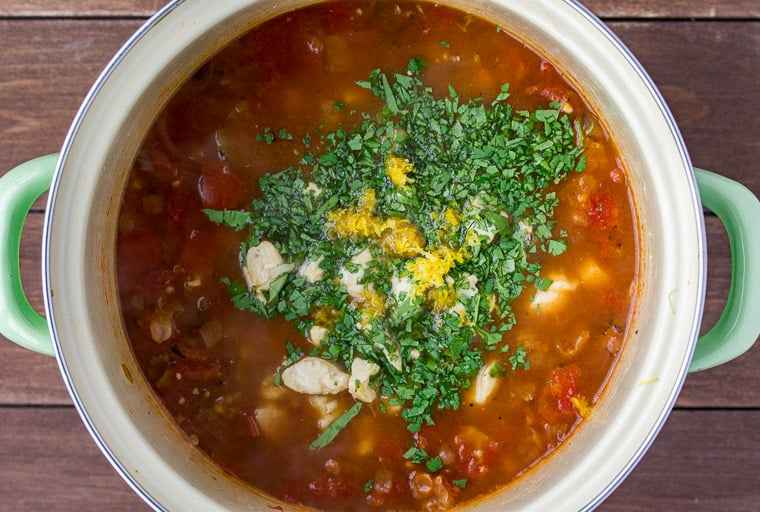 Chicken, Cilantro, and Lemon Added to the Soup in a Stock Pot