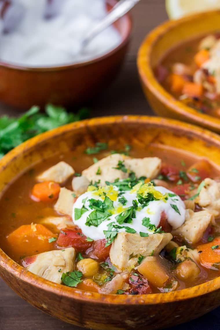 Moroccan Inspired Chicken Stew in an Orange Wooden Bowl