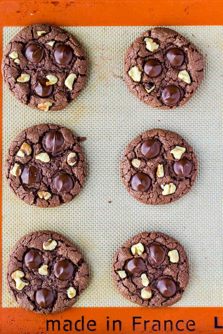 6 Chocolate Cookies with Walnuts and Chocolate Chips Baked on a Silpat Mat