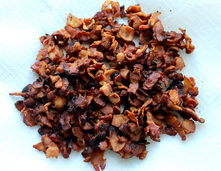Cooked, diced bacon on a paper towel