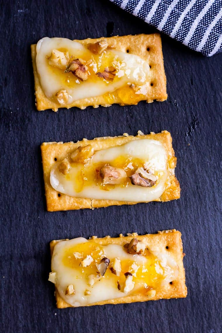 close up of 3 apricot jam cracker on a piece of slate
