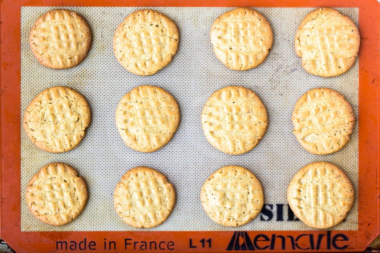 Baked Peanut Butter Cookies on a silpat mat