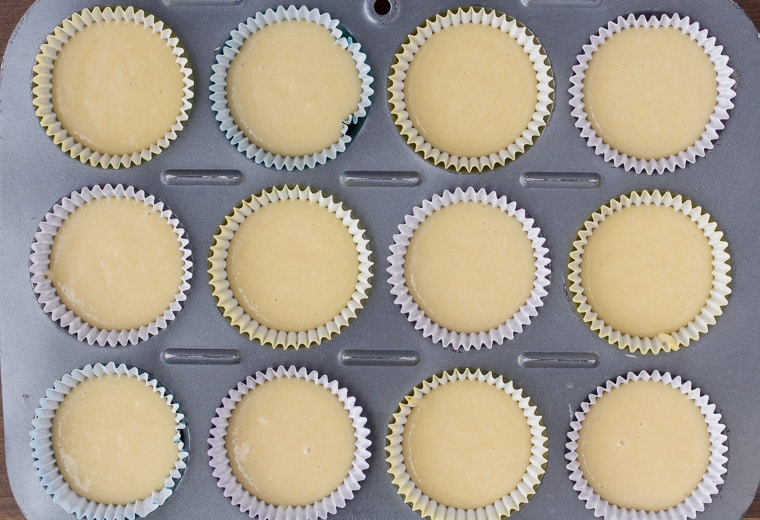 Cupcake pan filled with liners and vanilla cupcake batter