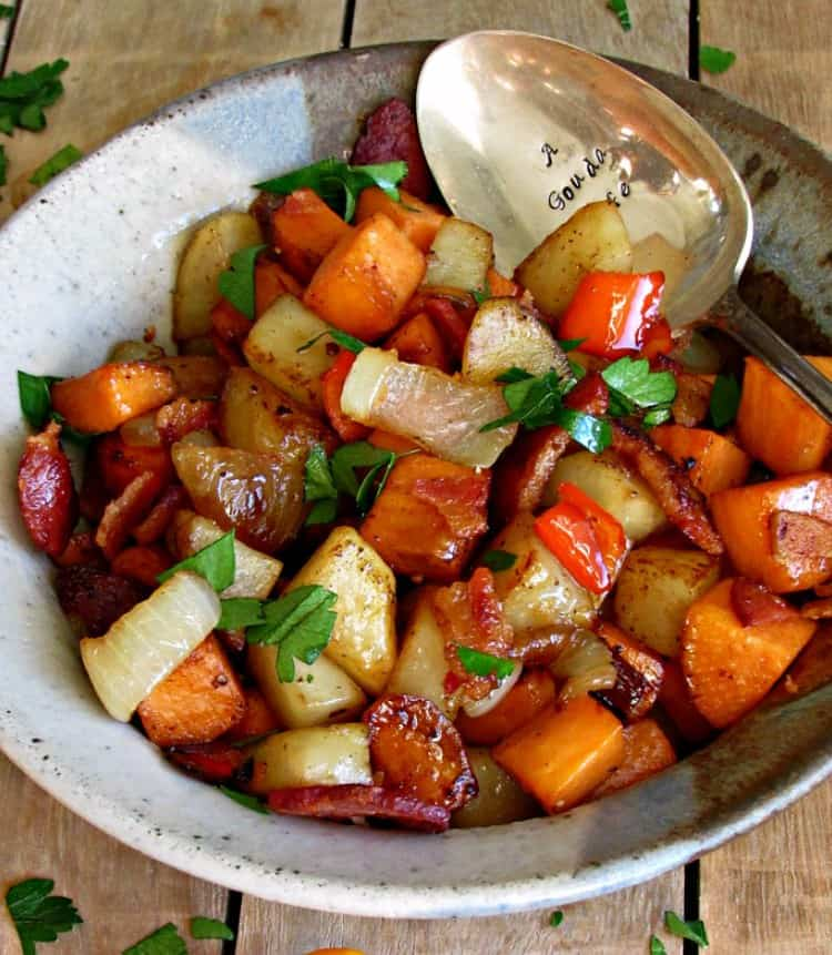 Bacon Sweet Potato Hash in a silver bowl with a spoon on a wood background
