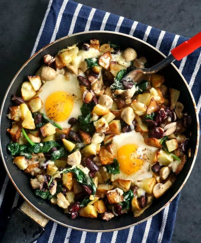 Potato hash with eggs, mushrooms and beans