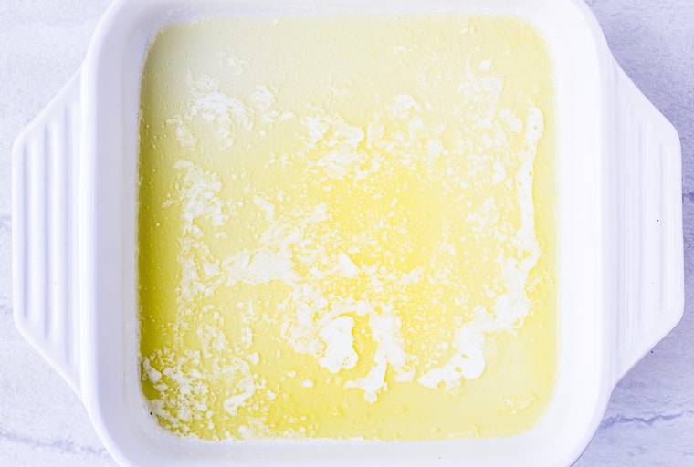 Melted Butter in the bottom of a white baking dish