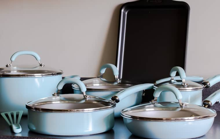 Rachael Ray Create Delicious Cookware opened on a gray counter