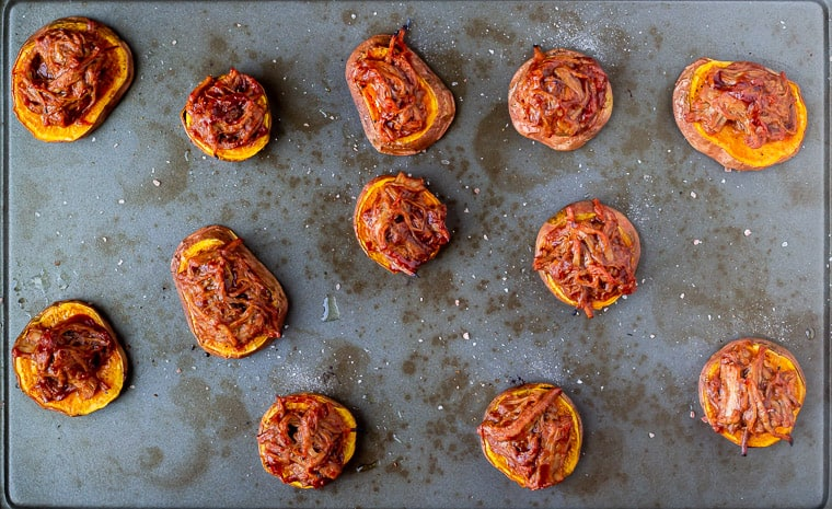 Roasted sweet potato rounds with barbecue pulled pork on top