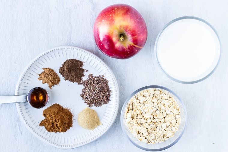 Ingredients needs to make Apple Pie Overnight Oats on a white background