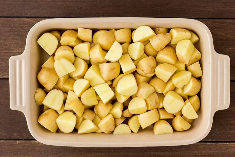 Diced Potatoes in a Baking Dish over a wood background