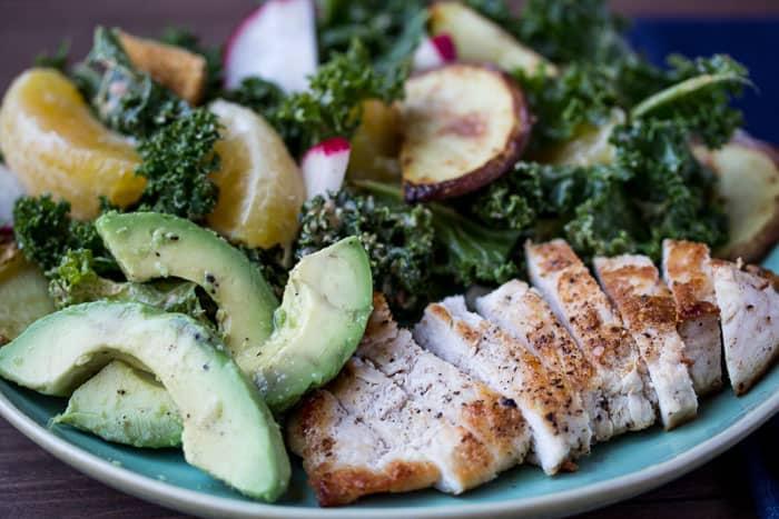 Chicken & Orange-Kale Salad on a Green Plate