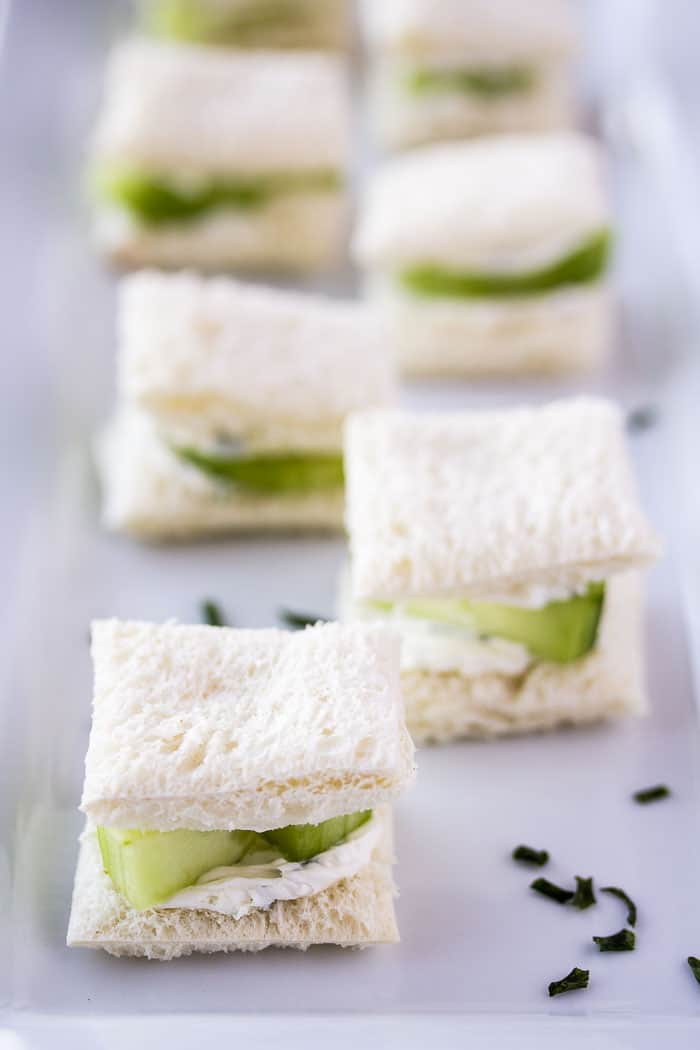 A Serving Tray with Mini Cucumber Tea Sandwiches