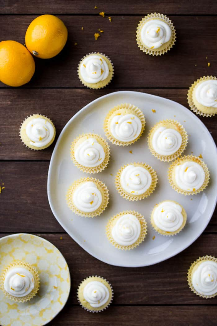 Overhead View of Mini Lemon Cupcakes on a Gray Plate on a Wood Background