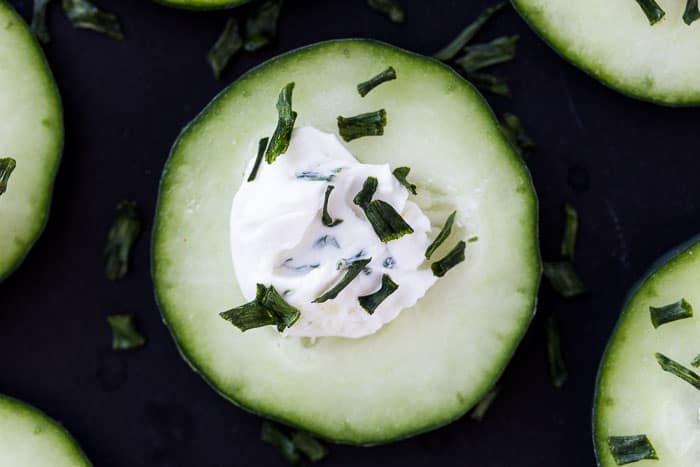 A Cucumber Slice with Cream Cheese and Fresh Herbs