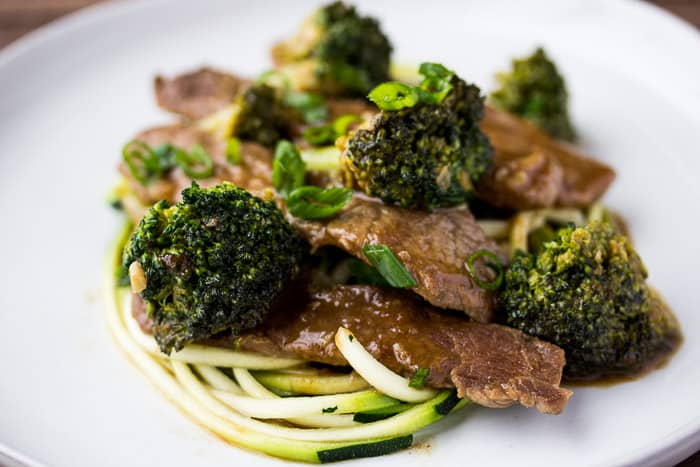 Low Carb Beef & Broccoli Zoodles up close on a white plate