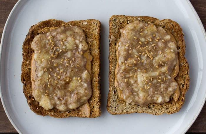 Toast Topped with Peanut Butter, Smashed Banana, and Flax Seeds