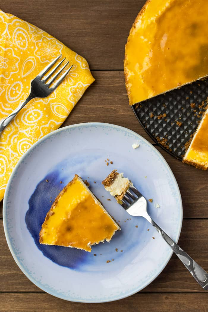 Overhead View of a Slice of Vanilla Orange Cheesecake with Orange Glaze