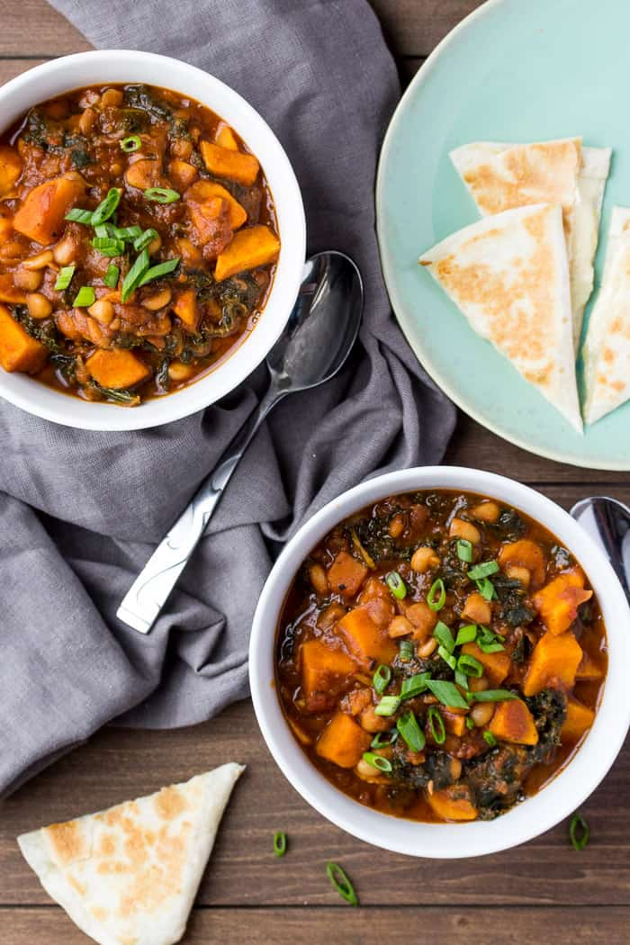 Blue Apron Spicy Sweet Potato Chili in Two Bowls with a Green Plate and Gray Napkin