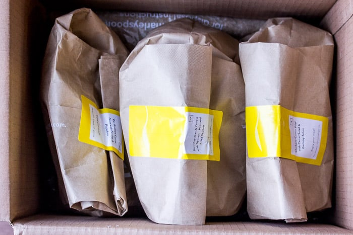 3 Brown Bags Containing Ingredients for the Recipes in a Box