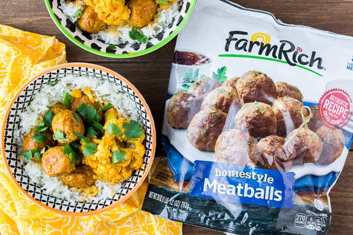 2 Bowls of Instant Pot Coconut Curry Meatballs with a Bag of Farm Rich Homestyle Meatballs and a Yellow Napkin