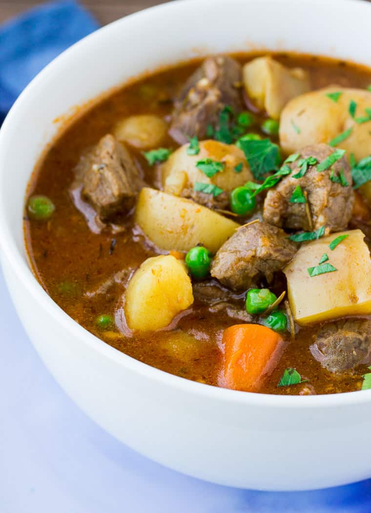 Instant Pot Homemade Beef Stew in a White Bowl on a Blue Plate