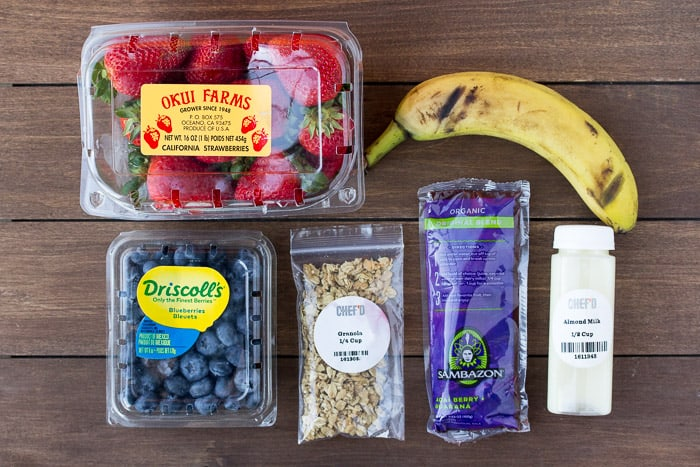 Ingredients for the Acai Bowls Laid Out on a Wood Backdrop