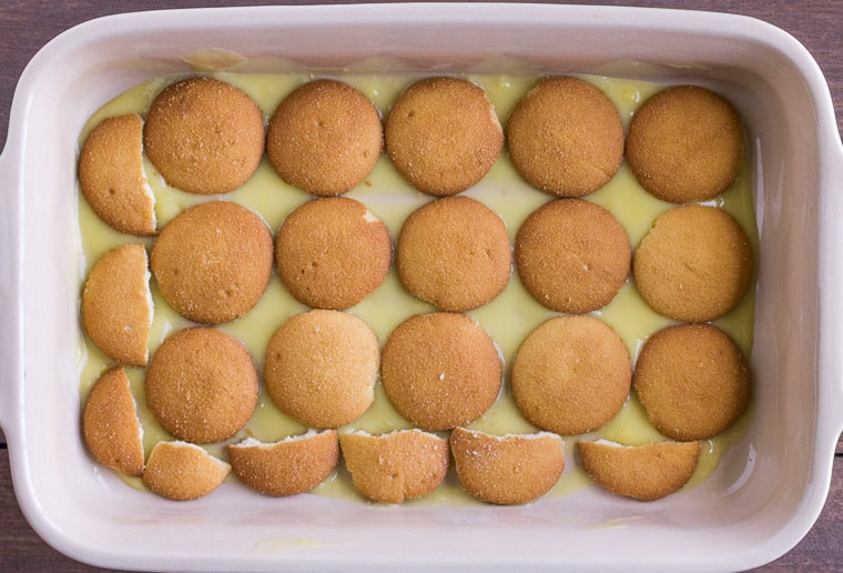 A layer NILLA Wafer Cookies on vanilla pudding in a rectangular baking dish