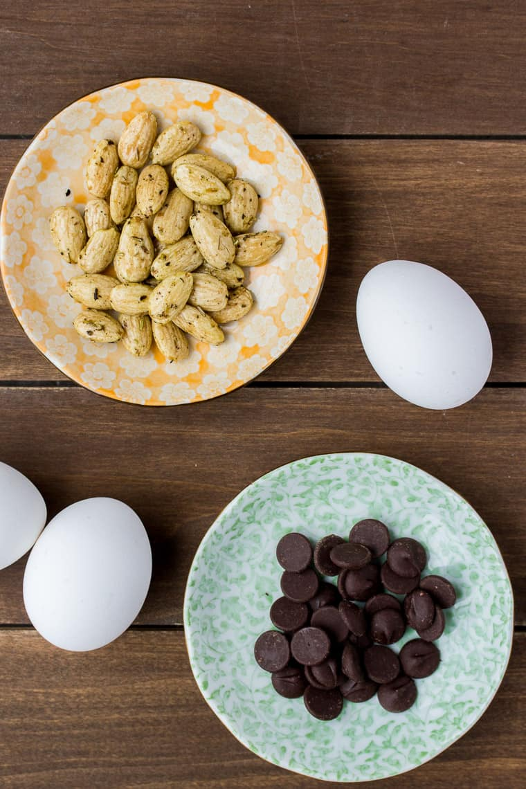 Almonds, Chocolate, and Eggs on a Wood Backdrop