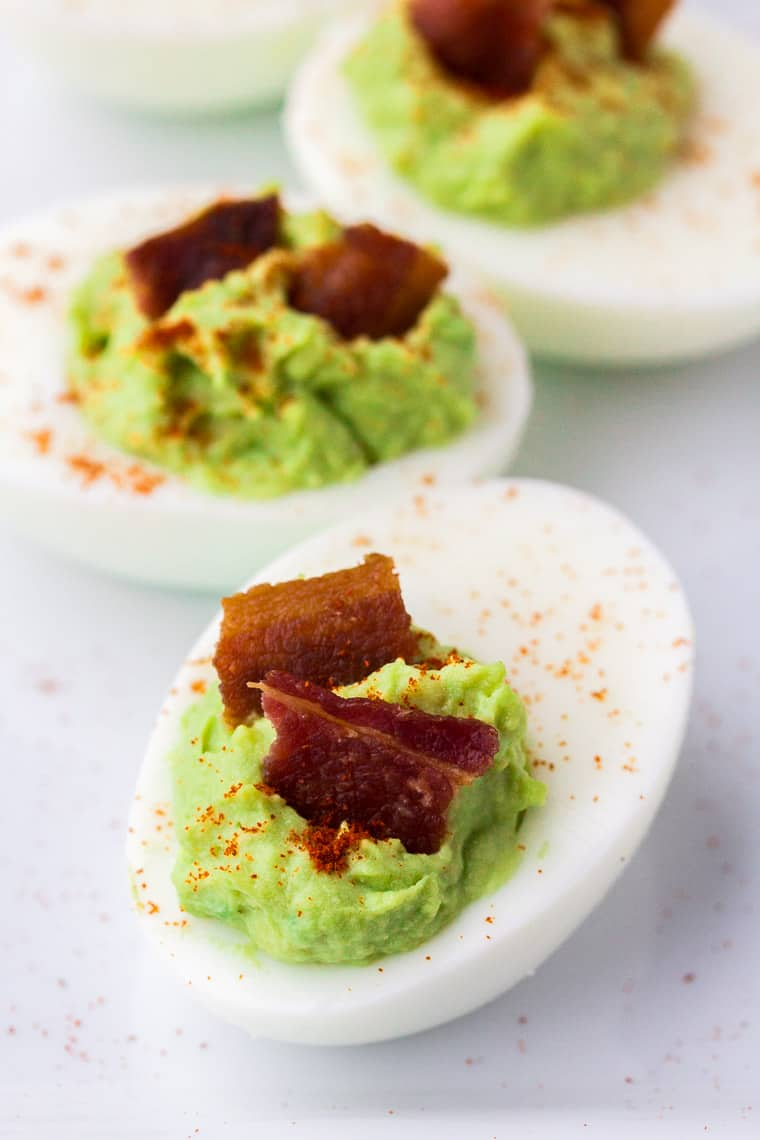 3 Bacon Avocado Deviled Eggs on a White Plate