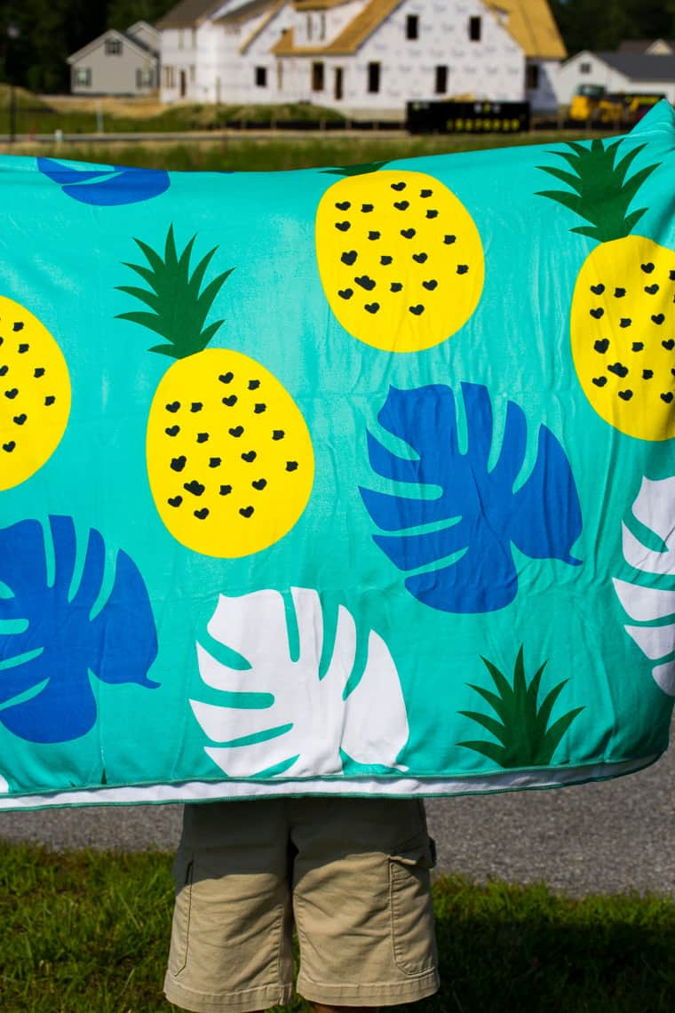 The Pineapple Beach Towel Held Up to Show the Design