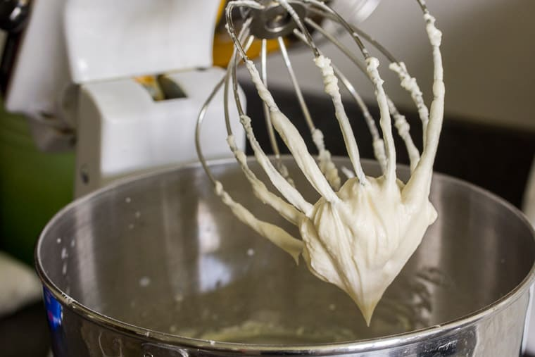 Cake Icing on the Whisk of an Electric Mixer