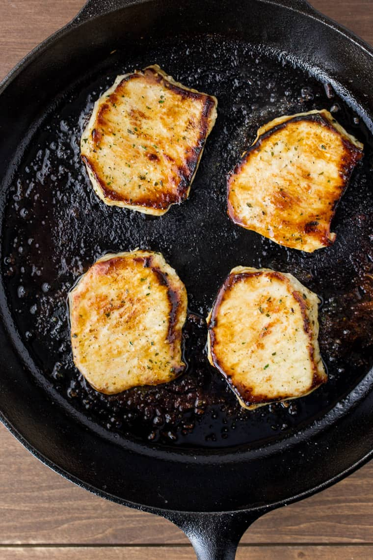 Cooked Pork Chops in a Cast Iron Pan