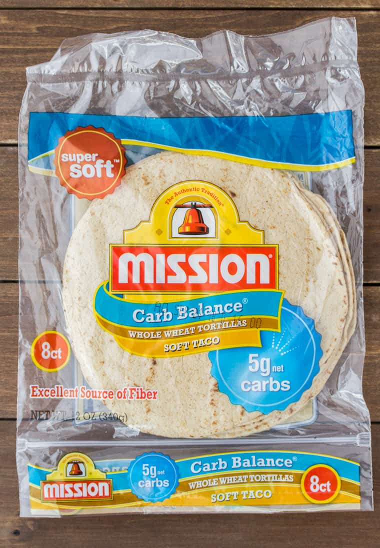 Mission® Carb Balance Whole Wheat Tortillas on a Wood Back Drop