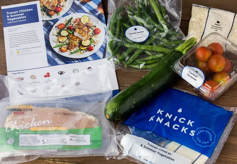 Blue Apron Tuscan Chicken & Summer Vegetables Ingredients on a Wood Back Drop