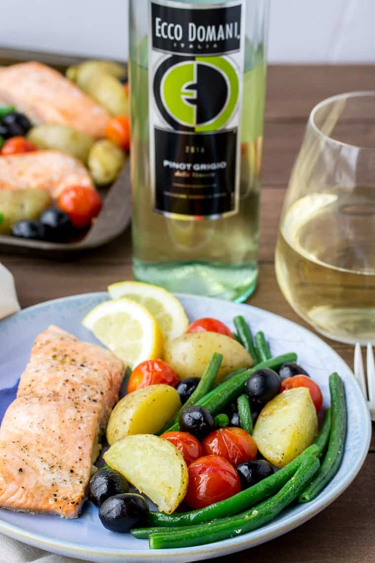 Baked Salmon and Vegetables on a Blue Plate with Ecco Domani Pinot Grigio Bottle in the Background with a Glass of Wine