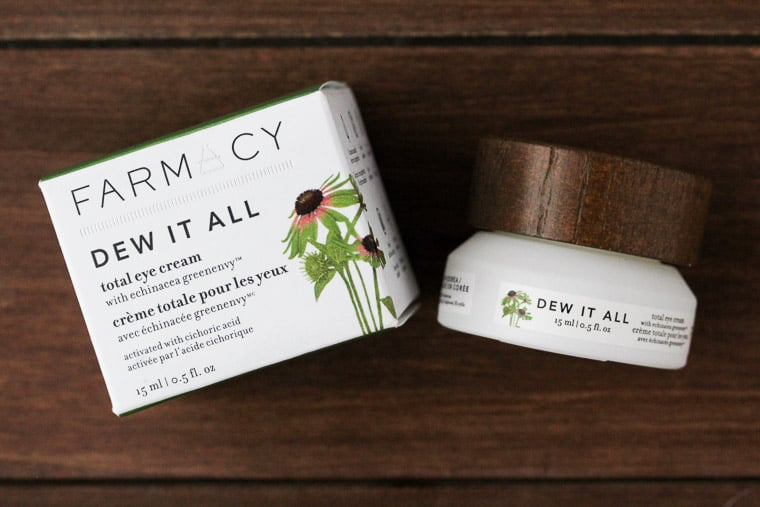 Farmacy Dew It All Eye Cream on a Wood Backdrop