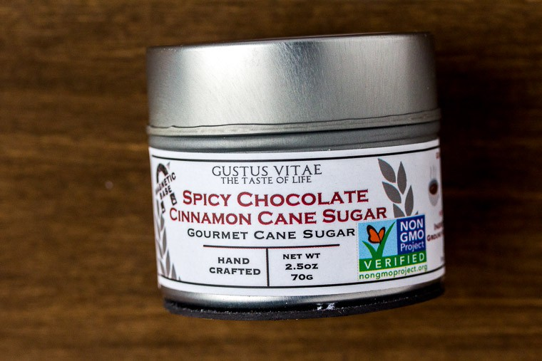 Gustus Vitae Spicy Chocolate Cinnamon Sugar on a Wood Backdrop