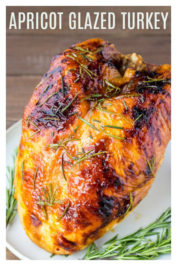 Rosemary Apricot Glazed Turkey is the perfect turkey recipe for Thanksgiving dinner! It's sweet, savory, and a beautiful centerpiece on your holiday table! | #dlbrecipes #turkeyrecipe #thanksgiving #apricotglazedturkey #turkey