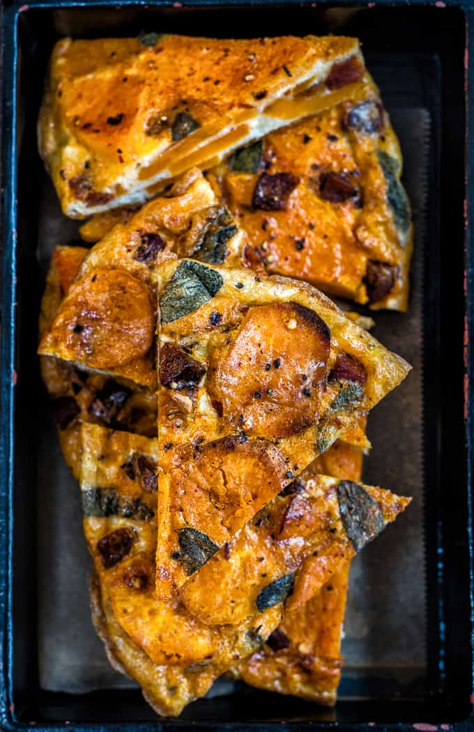 Spanish Butternut Squash Tortilla Cut in Triangles with Dark Background