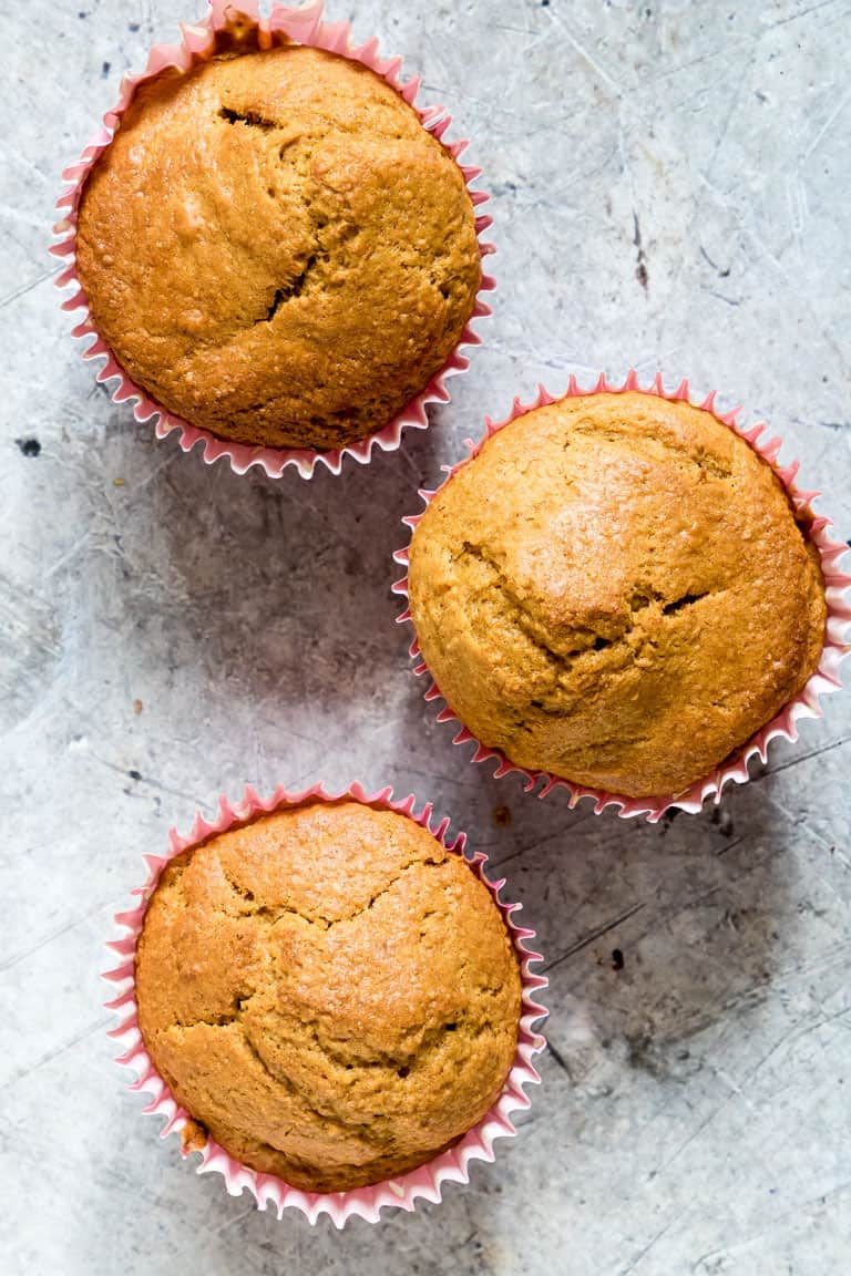 3 Butternut Squash Muffins on a Gray Backdrop