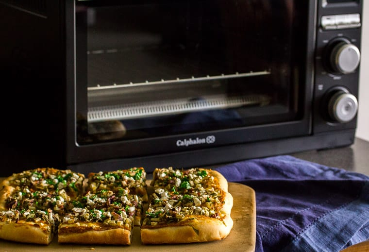 Baked Flatbread Next to the Calphalon Precision Control Countertop Oven