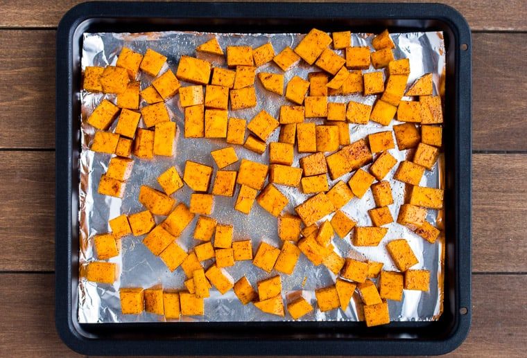 Butternut Squash Cubes on foil on a baking sheet