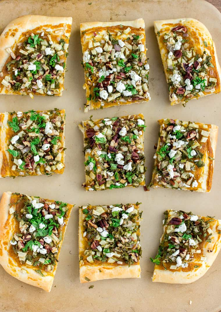 Butternut and Apple Fall Harvest Flatbread Pizza cut into 9 pieces on a pizza stone