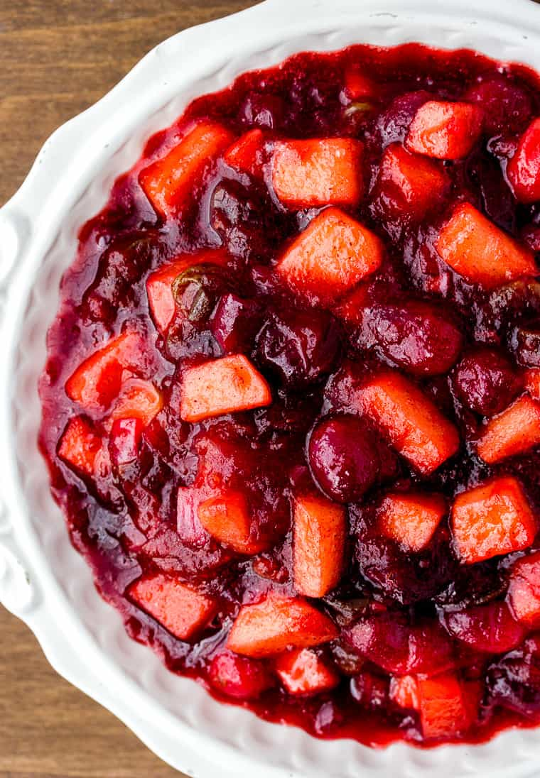 Cranberry Apple Chutney in a White Serving Dish on a Wood Backdrop
