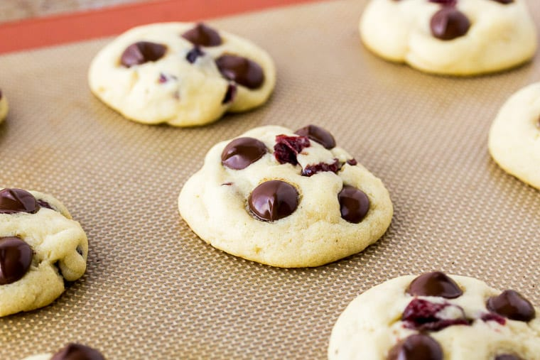 Baked Dark Chocolate Chip Cranberry Cookies on a Silpat Mat