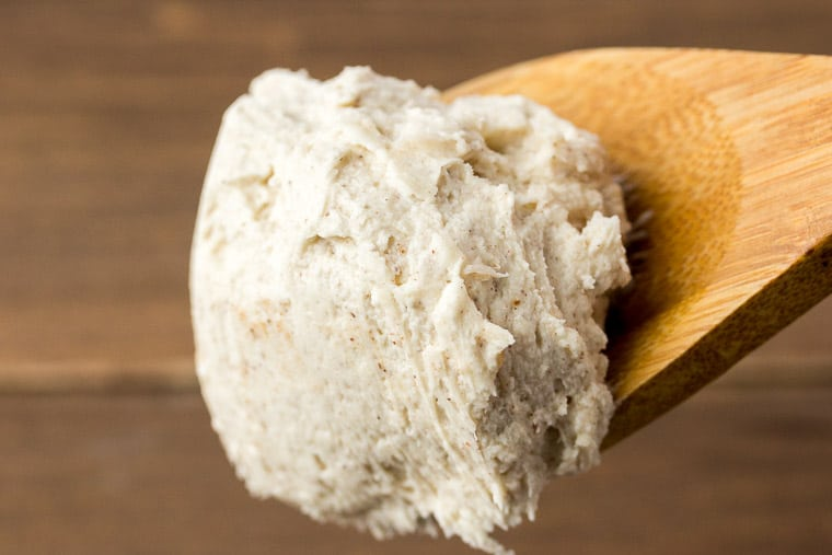 Cinnamon Vanilla Buttercream Frosting on a Wooden Spoon