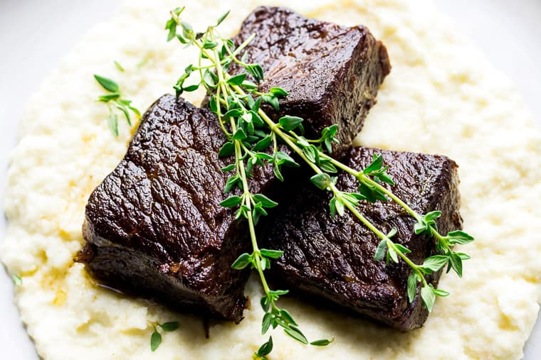 Garlic Butter Instant Pot Short Ribs Over Mashed Cauliflower and Topped with Fresh Thyme